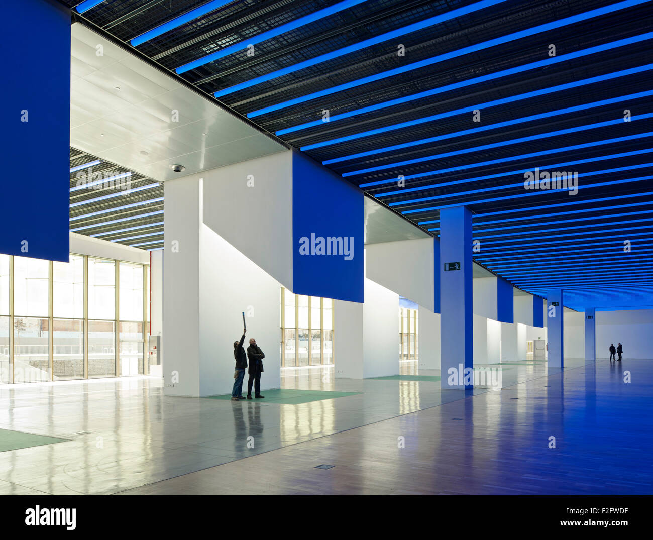 ... Skylight Columns And Ground Floor Gallery In Blue Light With  Silhouetted Figures. Museu Del Disseny