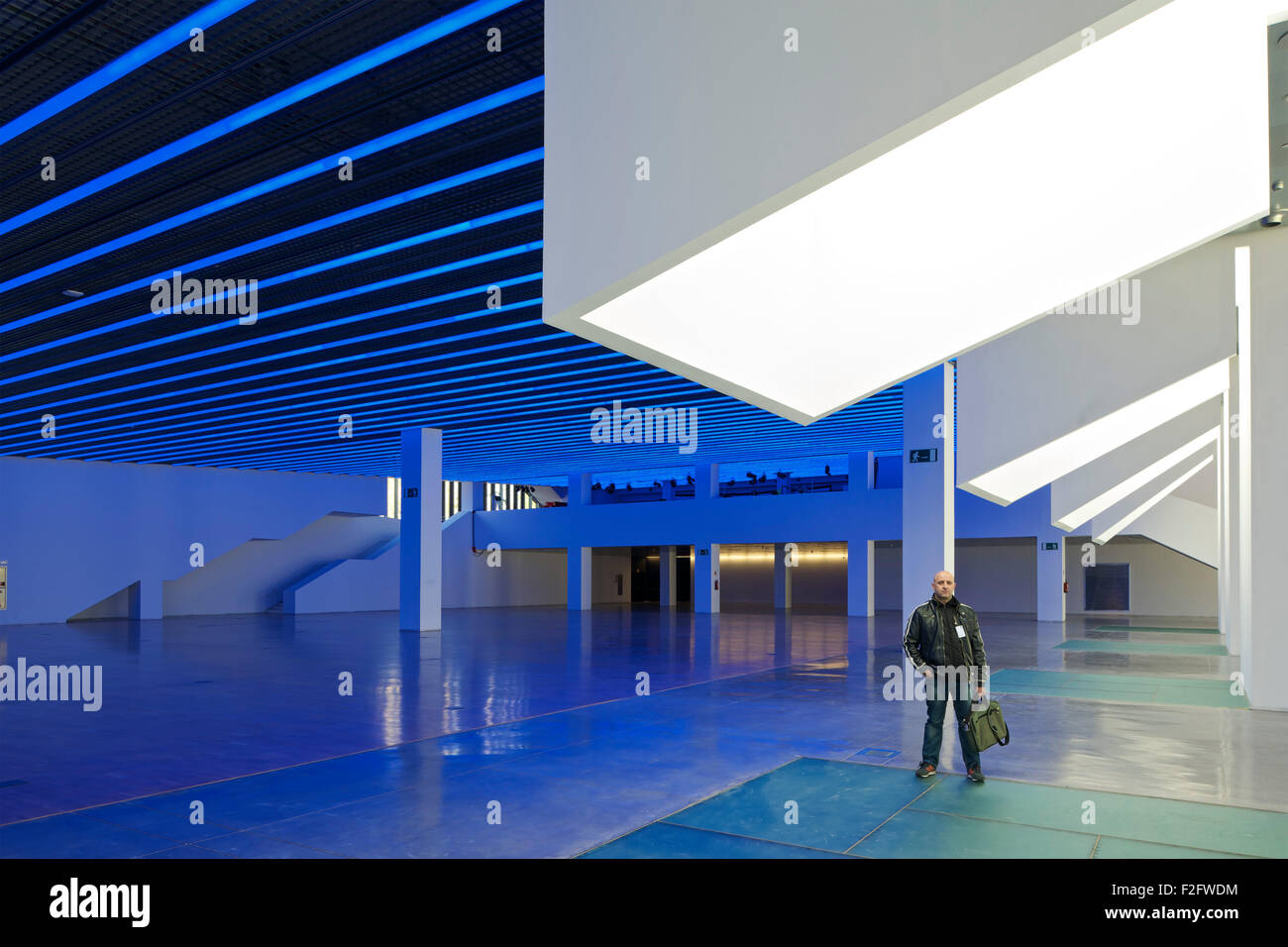 Skylight Columns And Ground Floor Gallery In Blue Light With Man Standing.  Museu Del Disseny De Barcelona, Barcelona, Spain. Arc