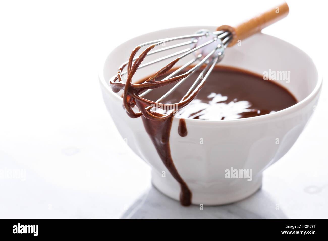 Melted chocolate in a bowl with a whisk Stock Photo, Royalty Free ...