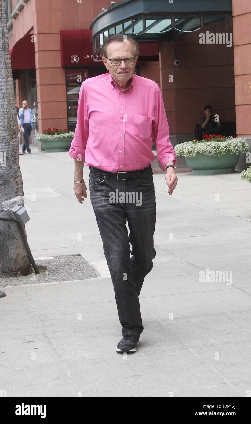 Larry King goes shopping in Beverly Hills in a pink shirt, jeans ...