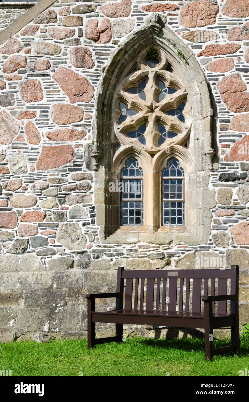 Seating Bench Underneath One Of The Decorated Stone Tracery Windows Outside Iona Abbey Church