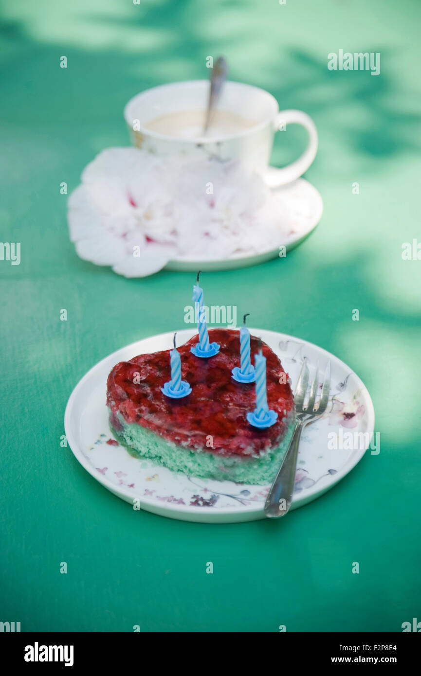 Heart shaped birthday cake and coffee cup with flowers stock photo heart shaped birthday cake and coffee cup with flowers izmirmasajfo