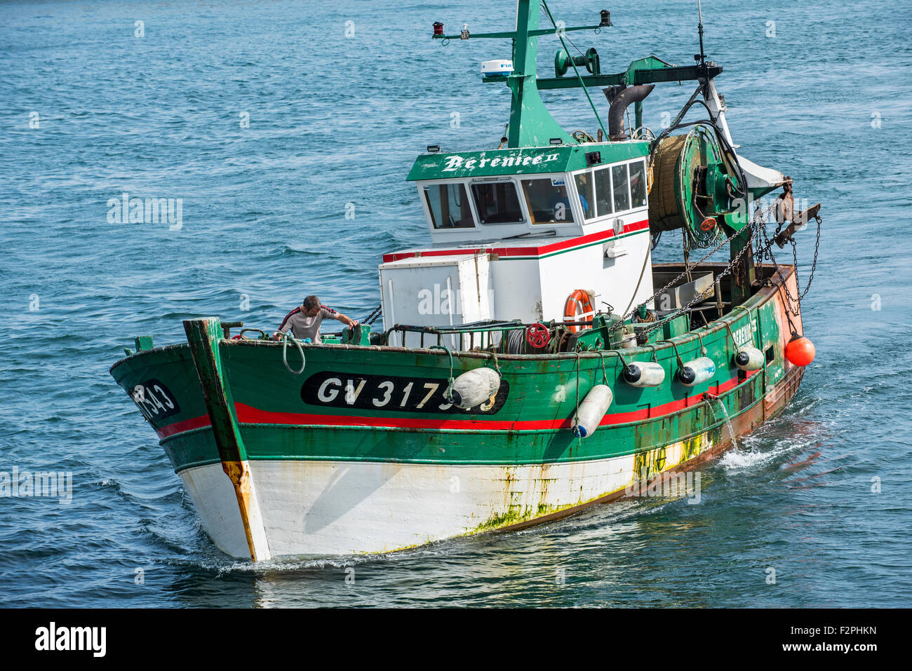 Fisherman on board of green wooden trawler fishing boat at for Sea fishing boats