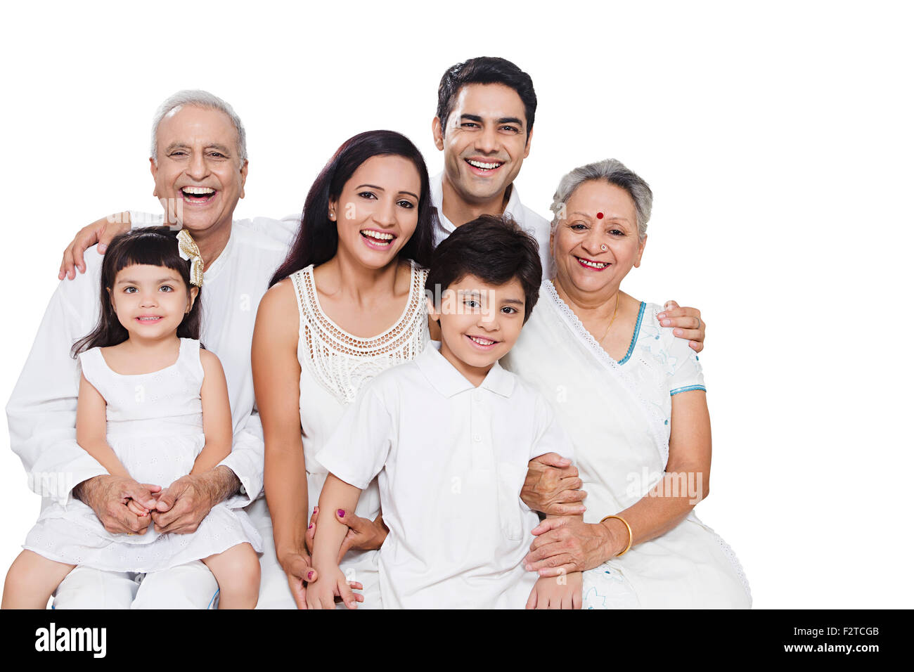 indian-group-joint-family-sitting-enjoy-F2TCGB.jpg