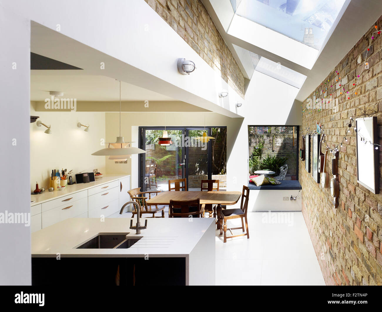 Kitchen View With Exposed Brick Wall And Rooflight. Princess May Terraced  Home, London, United Kingdom. Architect: Ullmayer Sylv