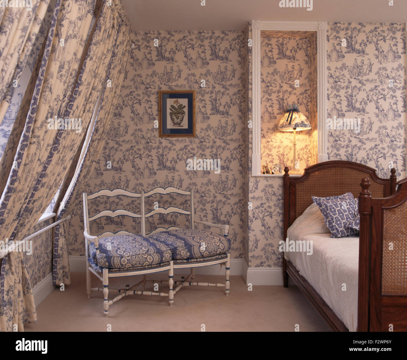Blue Toile De Jouy Wallpaper And Matching Drapes In Townhouse Bedroom With  A White Wooden Sofa