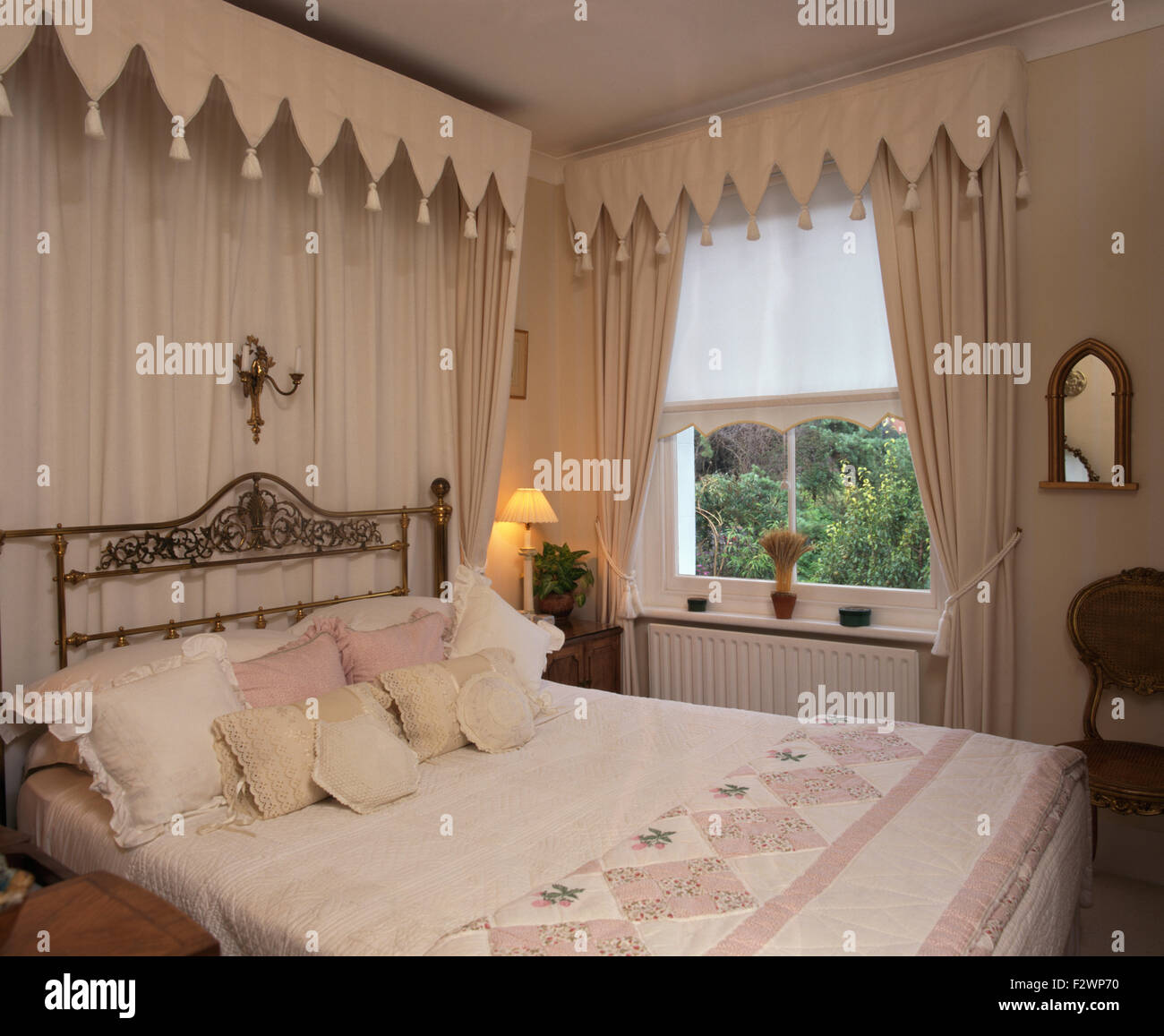 Gothic canopy bed curtains - Gothic Style Canopy And Drapes Above Brass Bed In Townhouse Bedroom With Cream Curtains And Pelmet