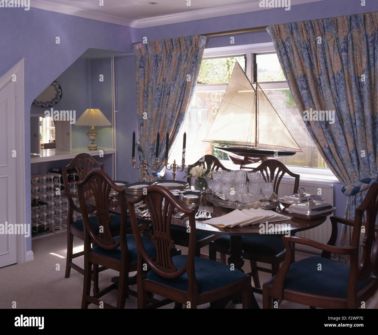 Stock Photo   Table set for lunch in nineties dining room with a model ship  on windowsillTable set for lunch in nineties dining room with a model ship on  . Ship Dining Room Set. Home Design Ideas