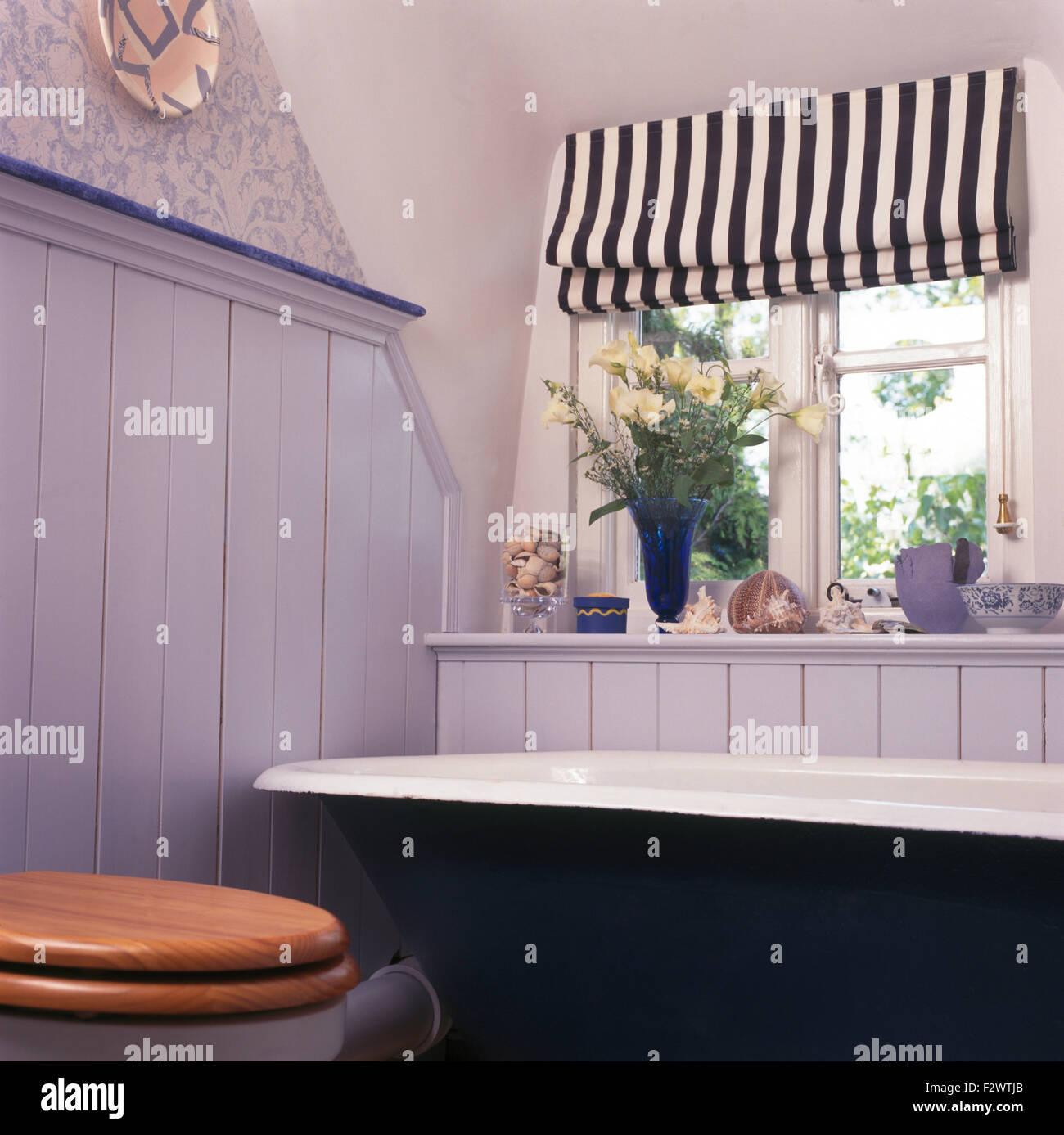 Tongue and groove for bathrooms - Black White Striped Blind On Window Above Roll Top Bath In Pale Blue Tongue