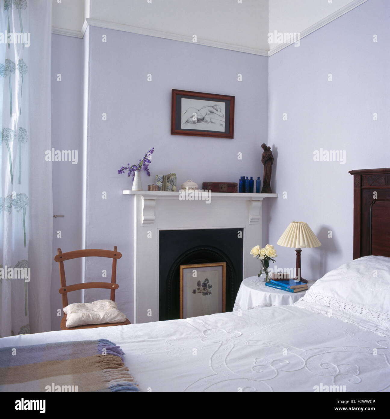 Mauve Bedroom Framed Drawing Above Fireplace With Firescreen In Small Mauve