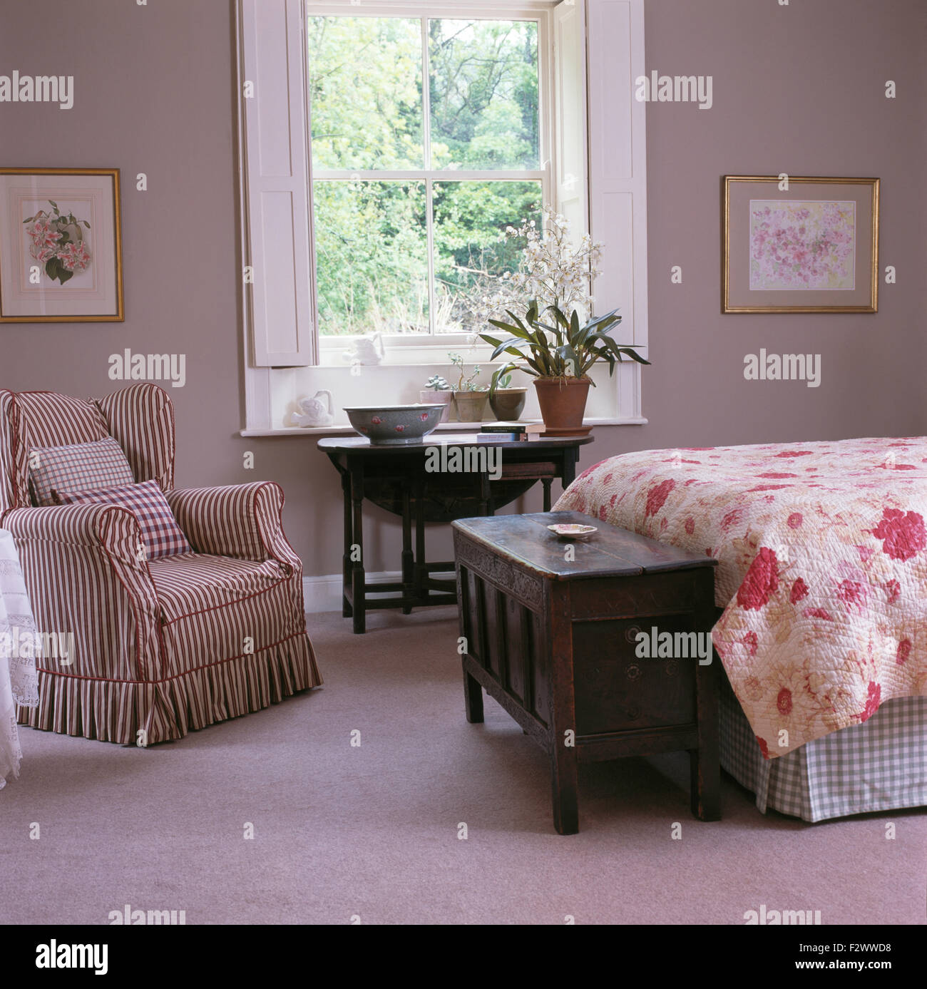 Pale Bedroom Striped Wing Chair And Antique Tables In Pale Grey Country Bedroom