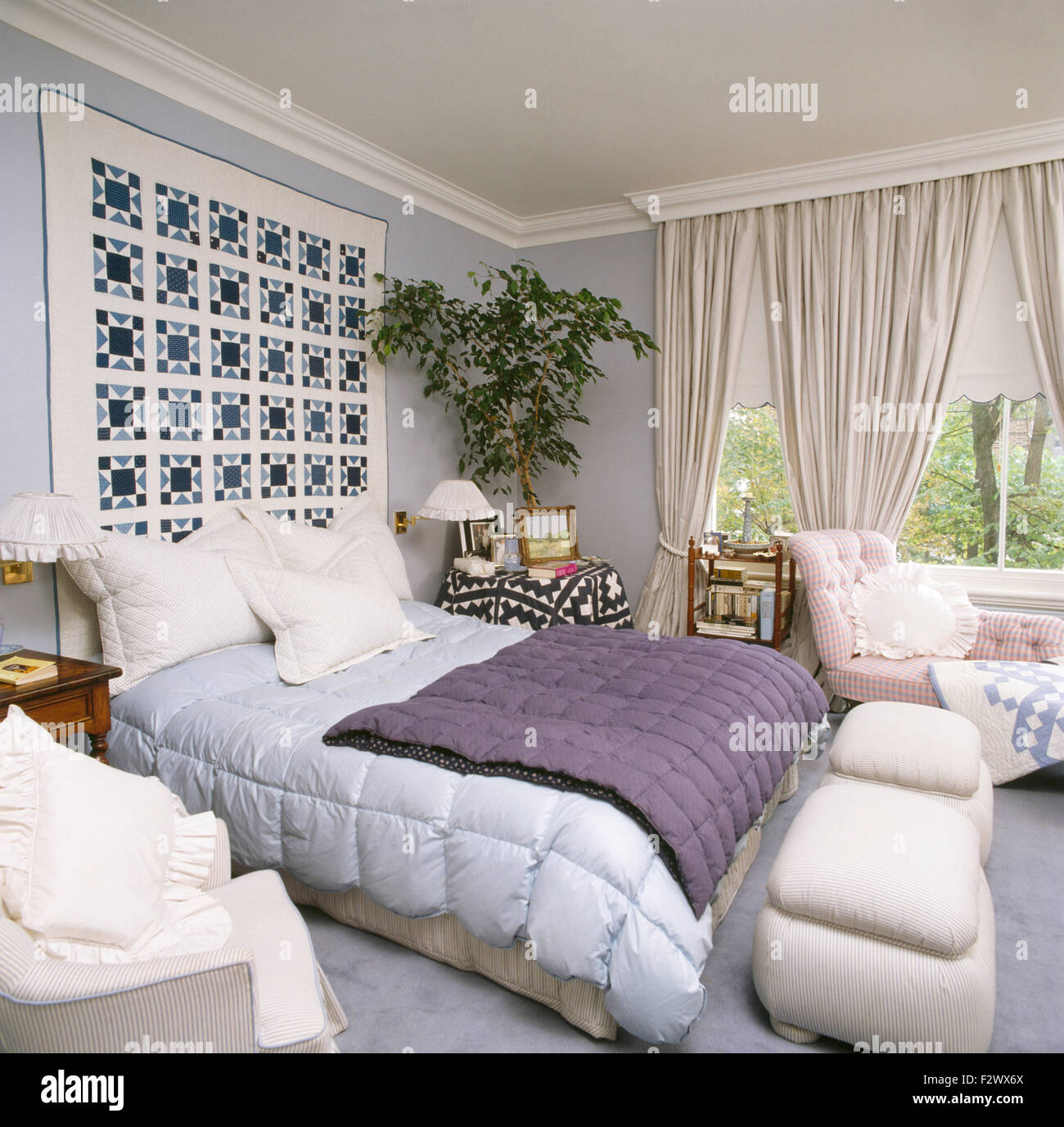 Pale Blue Bedroom Patchwork Quilt On Wall Above Bed With Pale Blue And Purple Quilts