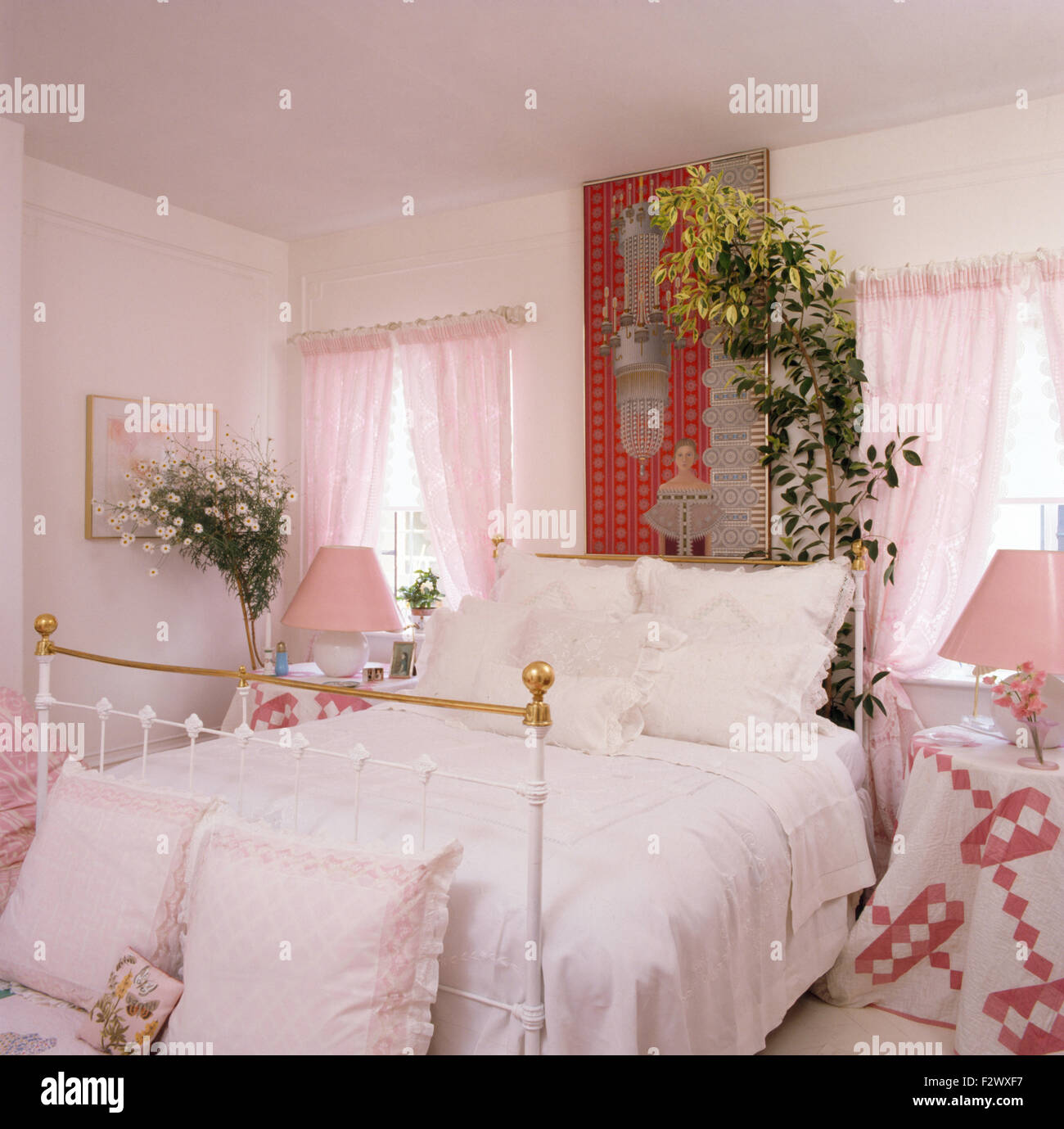 white lace trimmed pillows and cover on brass bed in nineties bedroom with pink voile drapes - Brass Beds