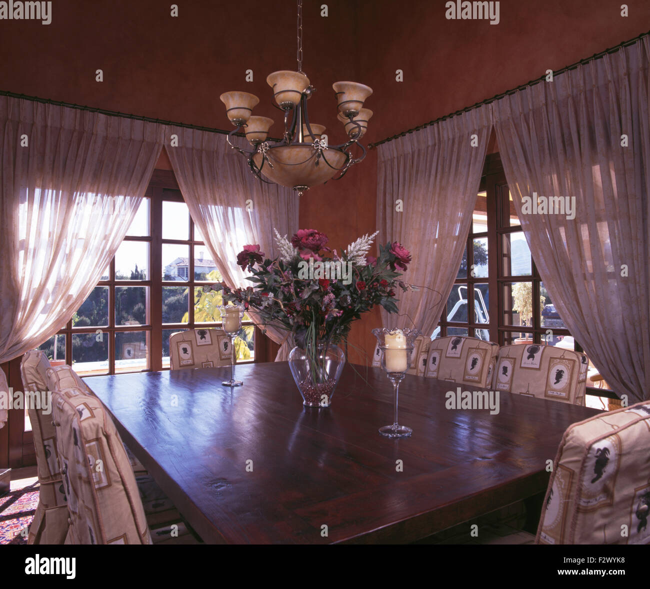 white curtains on french windows in spanish country dining room