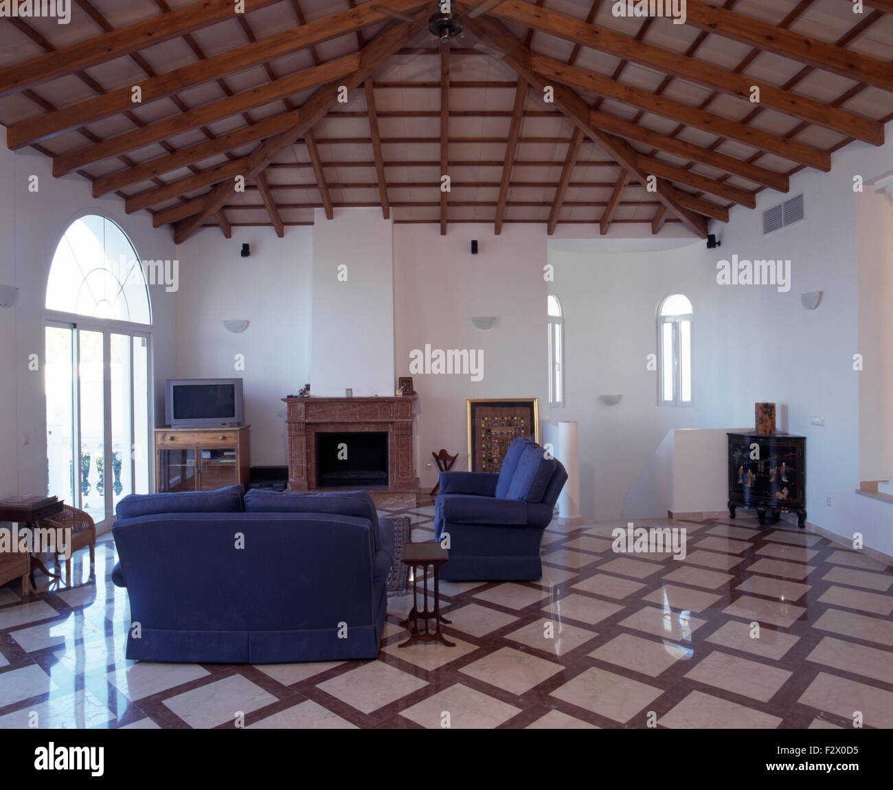 Ceramic Tiled Floor And Ceiling With Criss Cross Beams In