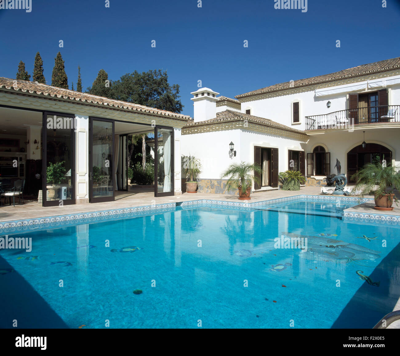 Turquoise swimming pool in front of large spanish villa with sliding stock photo royalty free for What is swimming pool in spanish