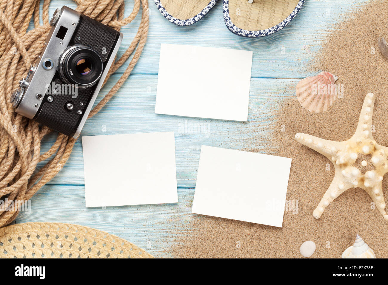 Stock Photo - Travel and vacation photo frames and items on wooden table.  Top view