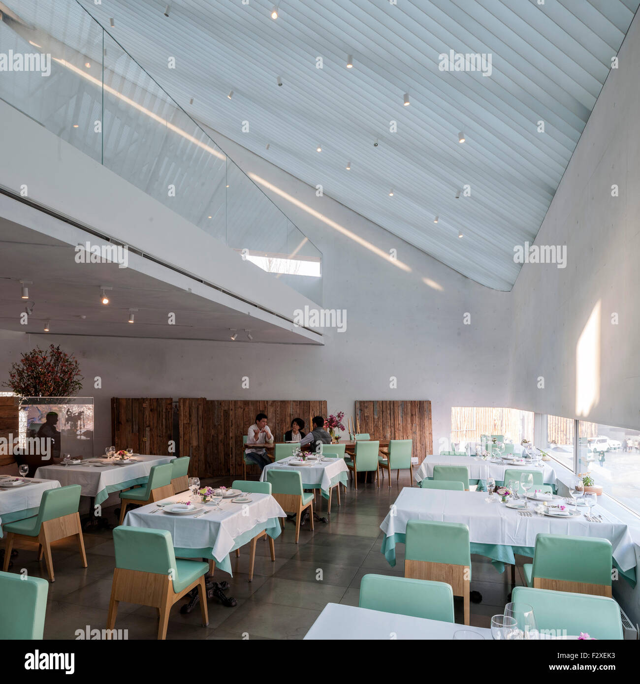 restaurant interior with louvred skylight and gallery. songwon art