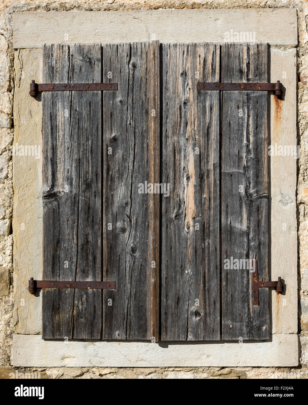 Wood Shutters Closed : Old window with closed gray wooden shutters stock photo
