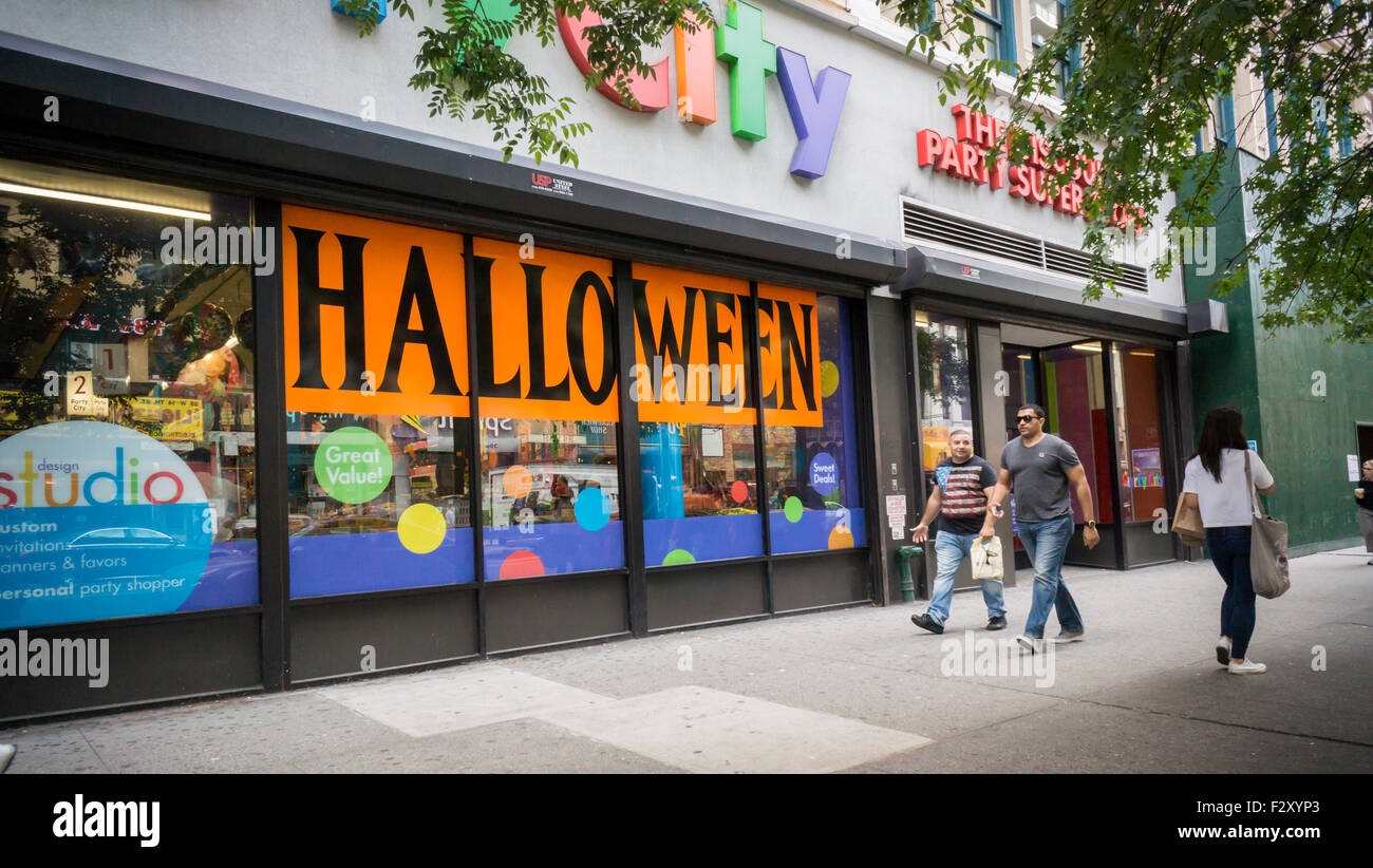 the window of a party city store in new york informs shoppers of all the halloween - Halloween Stores Ny