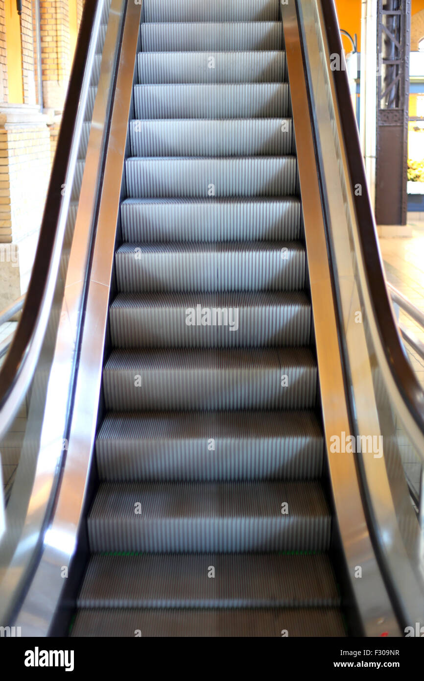 Moving Staircase To The Next Floorin The City Mall