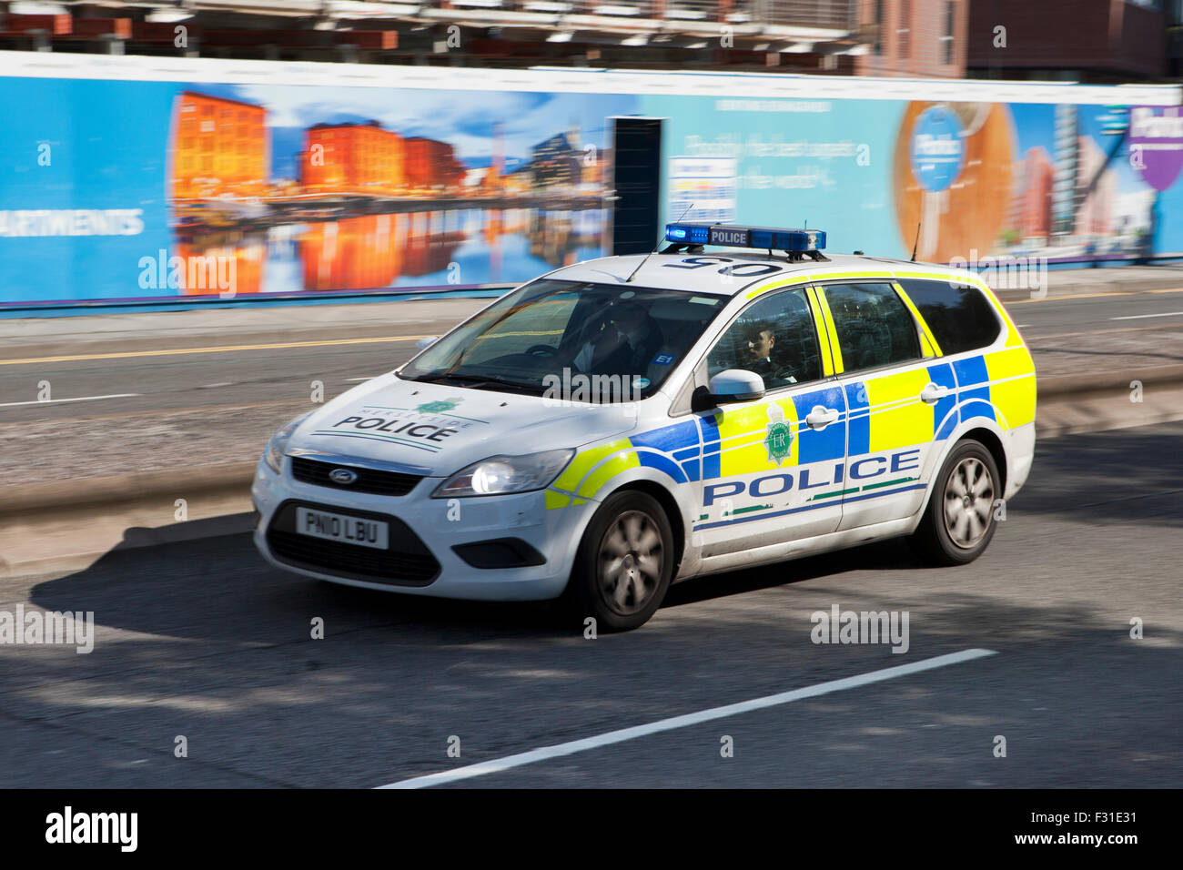 A blurred moving police car at speed motion blur on the strand at liverpool
