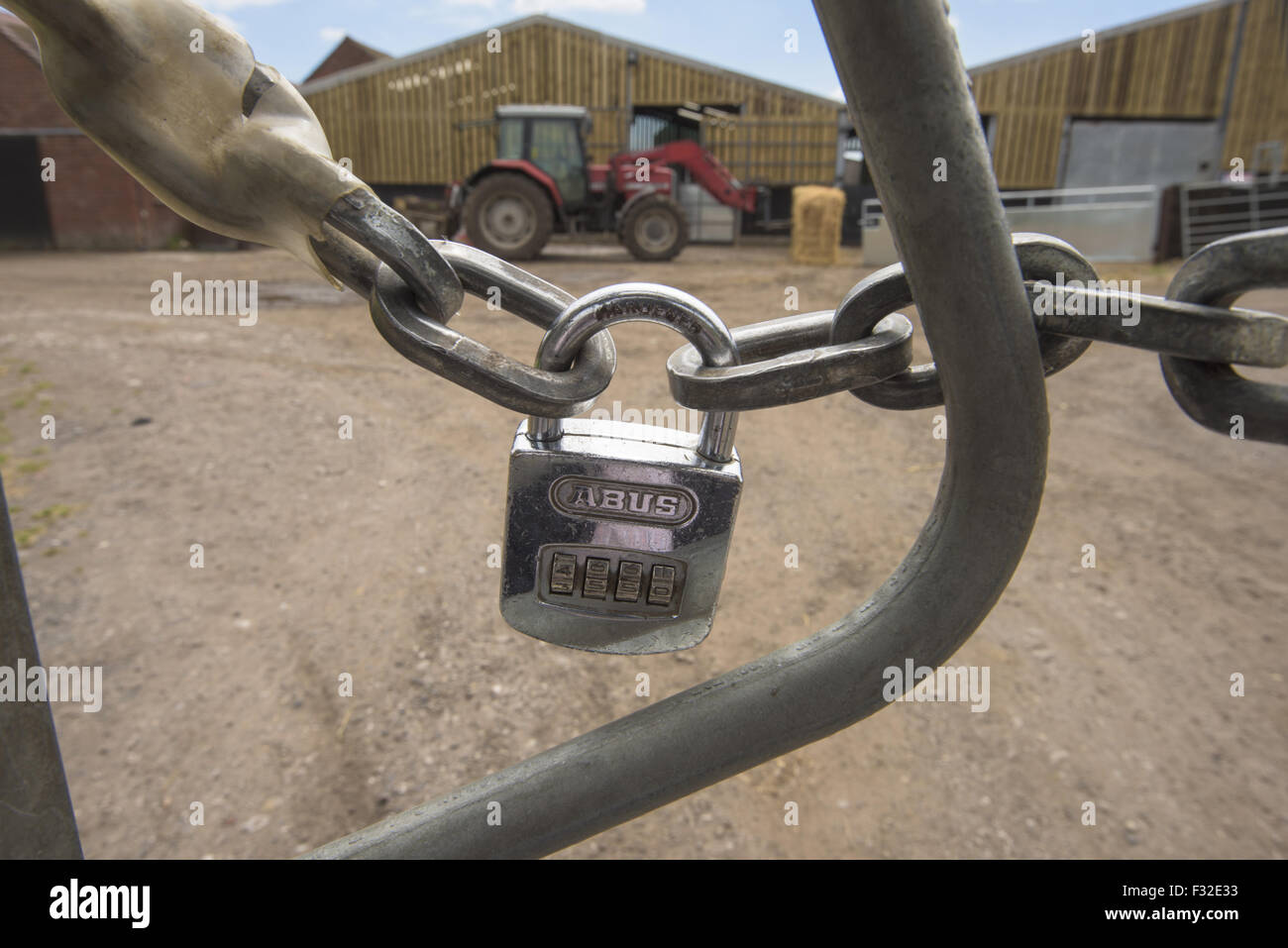 Tractor Chain Lock : Combination padlock and strong chain on farm gate with