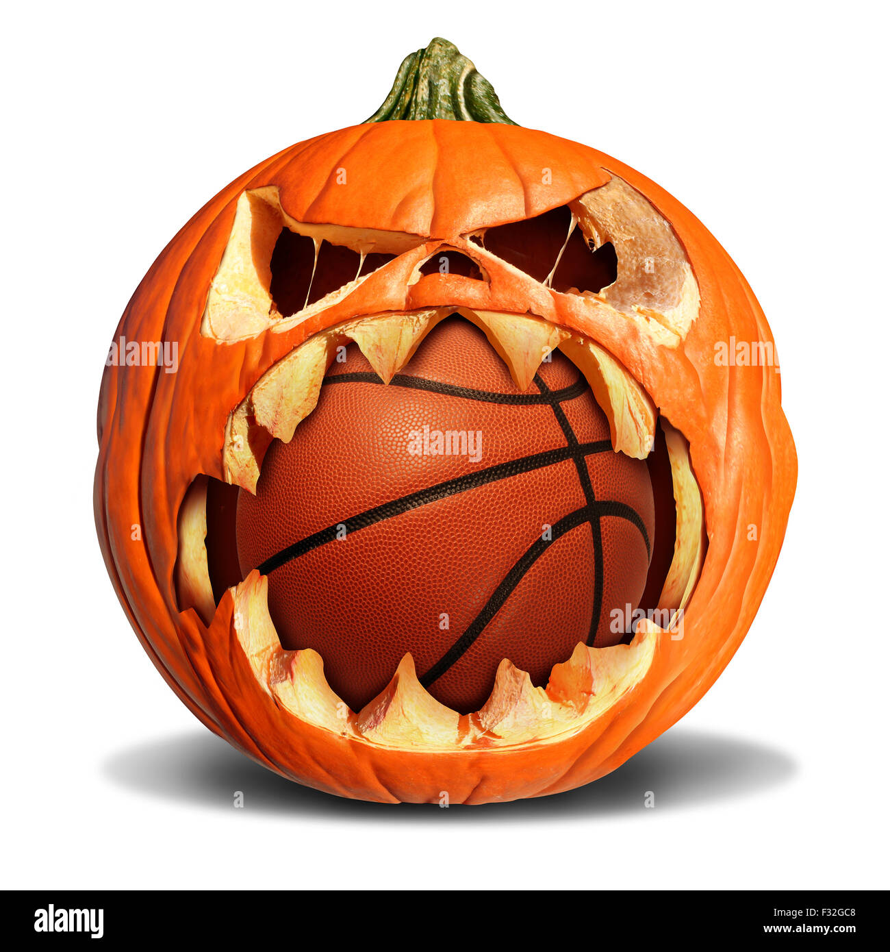Basketball autumn concept as a pumpkin jack o lantern biting into basketball autumn concept as a pumpkin jack o lantern biting into a leather softball as a symbol for halloween sports and fall sporting events on a white biocorpaavc Choice Image