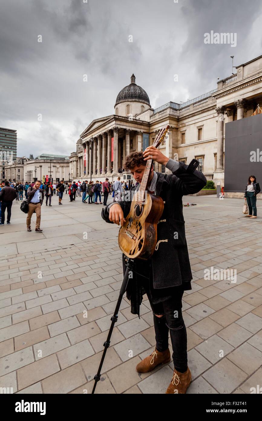 Fingerless gloves for musicians - A Street Musician Plays Outside The National Gallery Trafalgar Square London Uk
