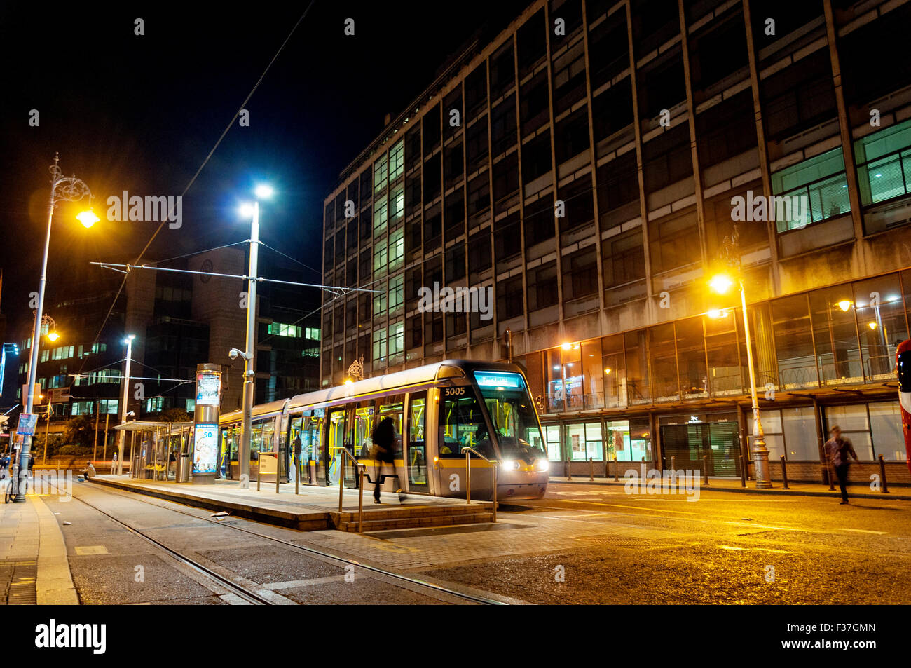 night time dublin ireland a luas tram at busaras stop. Black Bedroom Furniture Sets. Home Design Ideas
