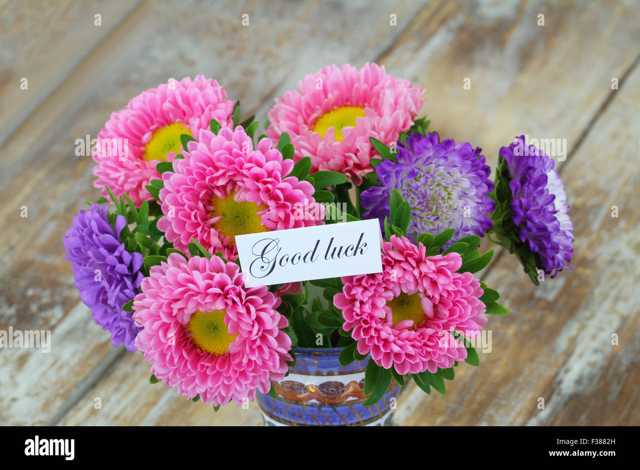 Good luck card with colorful aster flowers bouquet on rustic wooden stock photo royalty free - Flowers good luck bridal bouquet ...