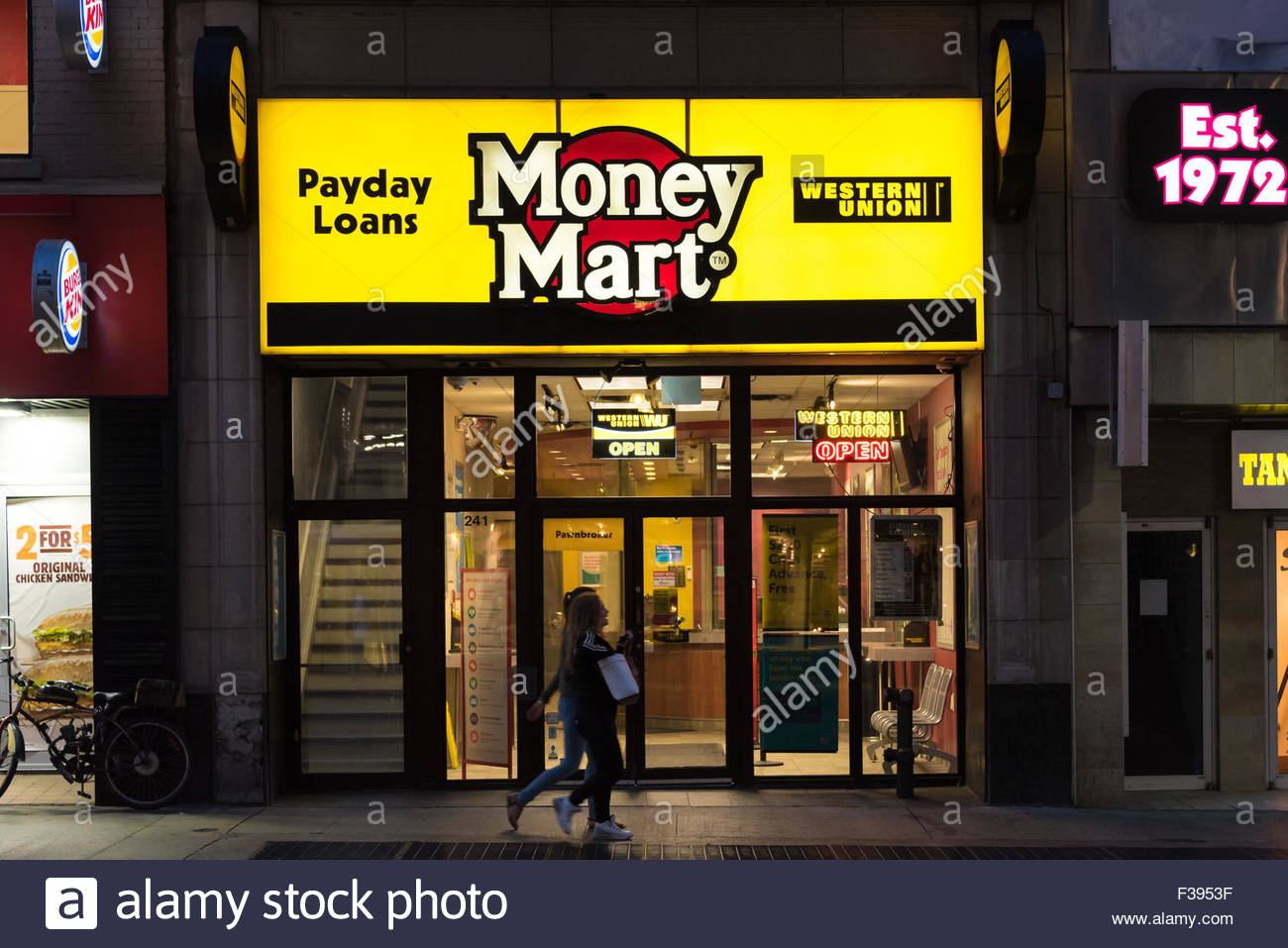 people walking in front of a money mart store in toronto national stock photo royalty free. Black Bedroom Furniture Sets. Home Design Ideas