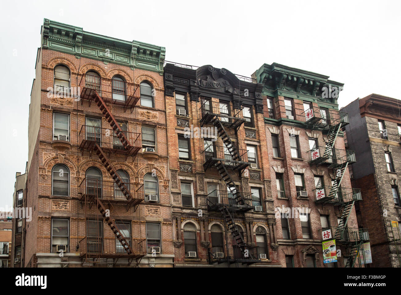 Typical new york city apartment building with fire escapes for Floor plans manhattan apartment buildings
