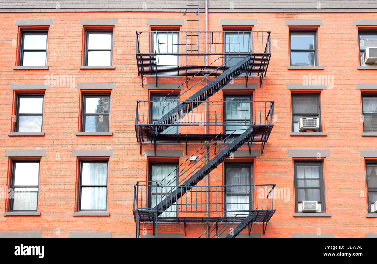 Apartment Building Fire Escape Ladder fire escape ladders, brick building in new york, usa stock photo