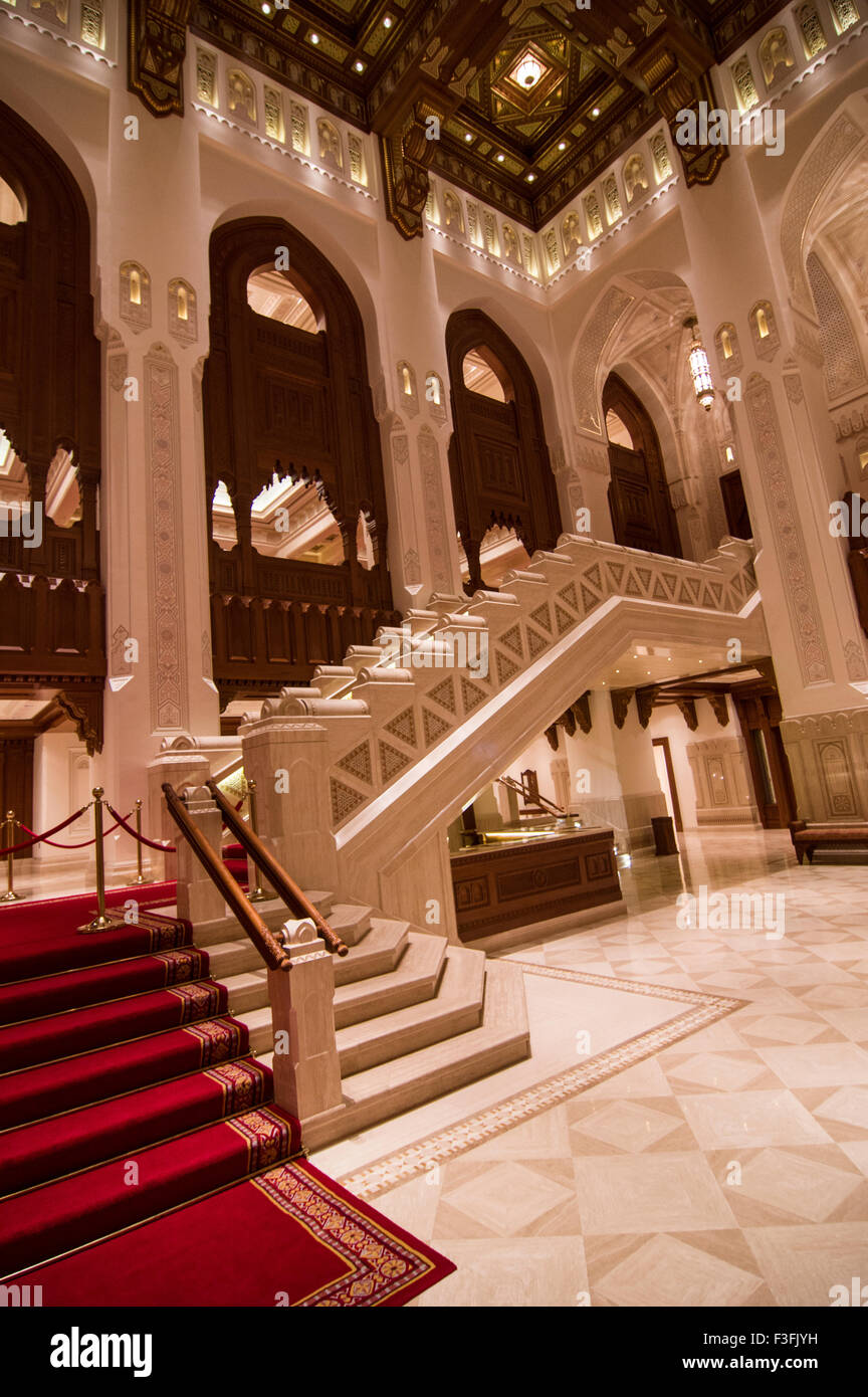 Lobby with high arches and an ornate wooden ceiling in the royal opera house in shati al qurm muscat oman