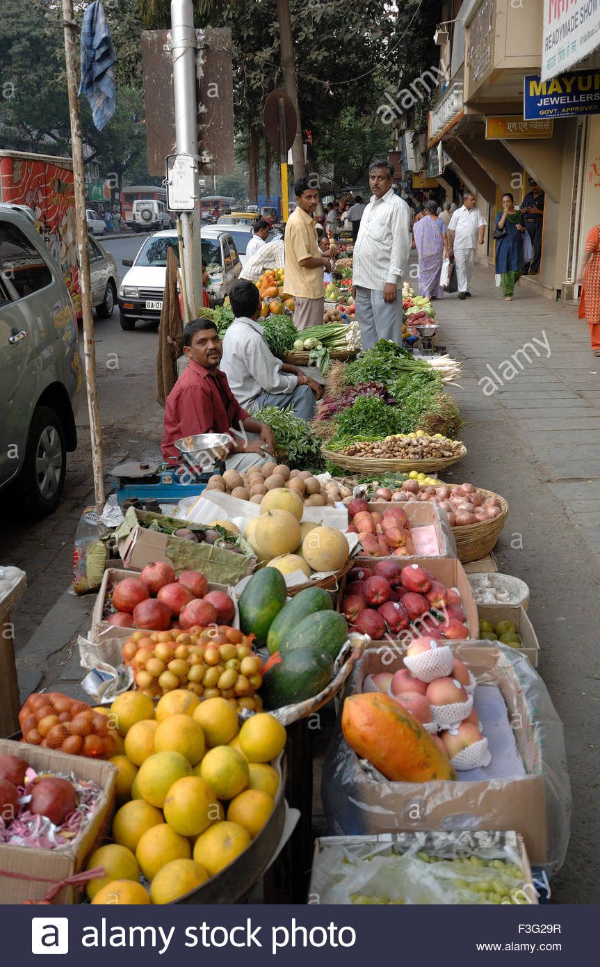 roadside hawkers selling fruits and vegetables in market mahim