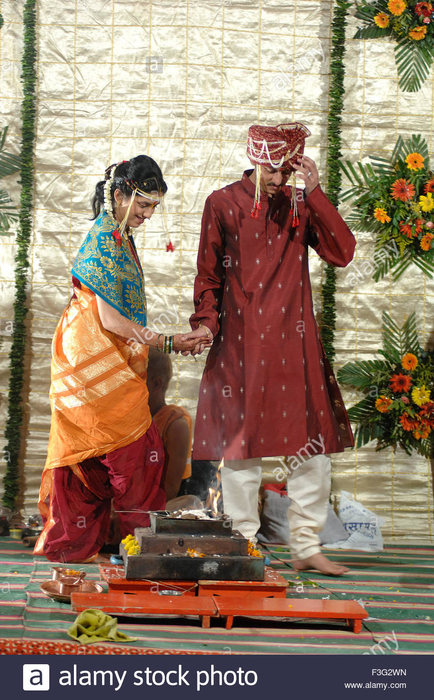 Hindu Bride And Bridegroom Walking Around Holy Fire Or Agni In Wedding Ceremony Mumbai Maharashtra India