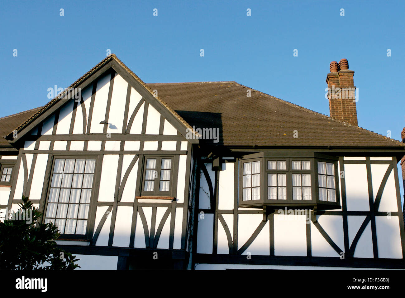 House With White Walls And Black Window And Brown Roof