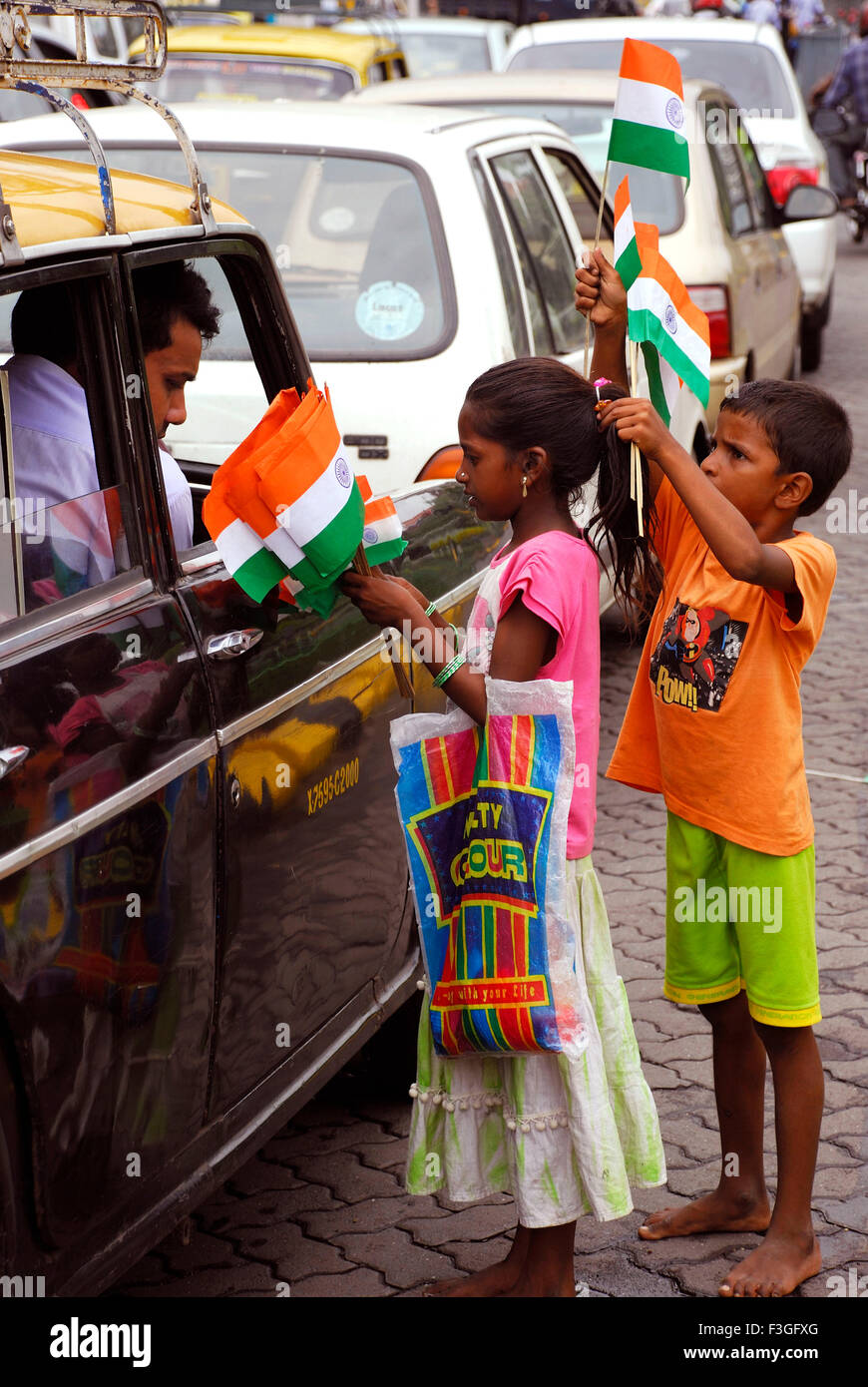 60th Independence Day ; children selling flags at traffic ...