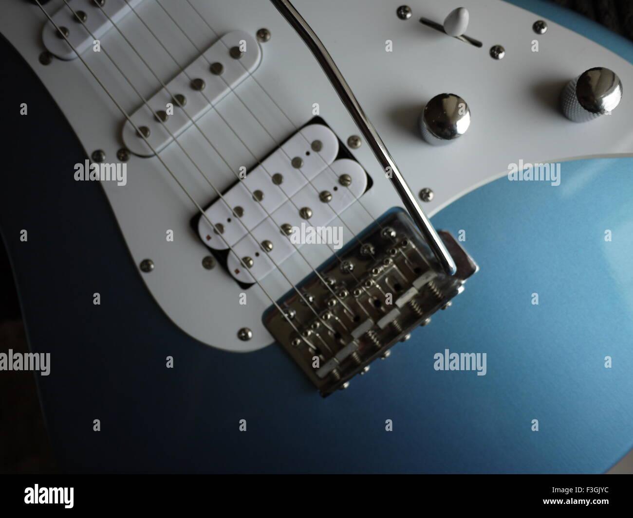 Light Blue Electric Guitar In Close Up