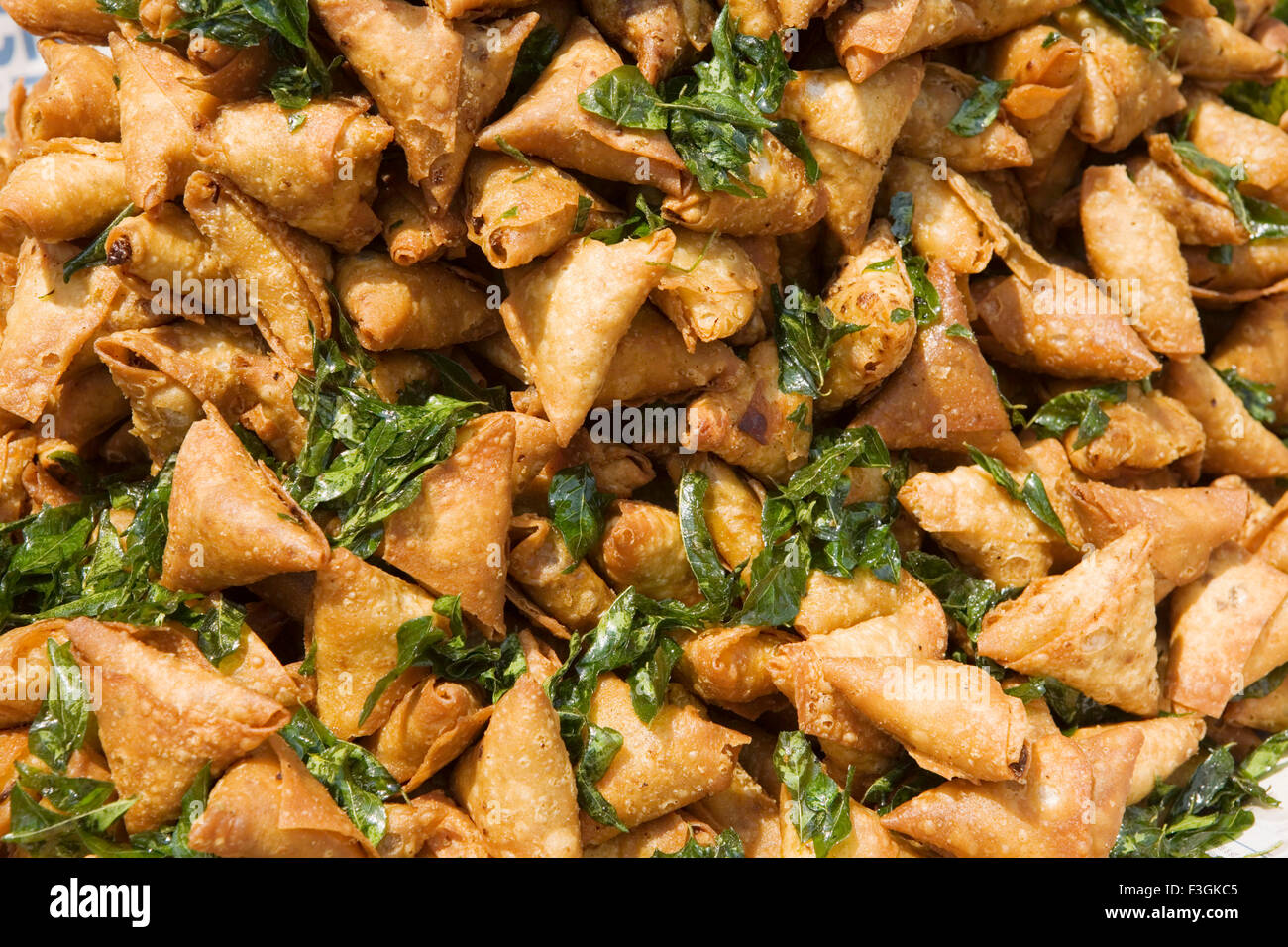 Samosa Indian snack displayed on roadside food stall with curry ...