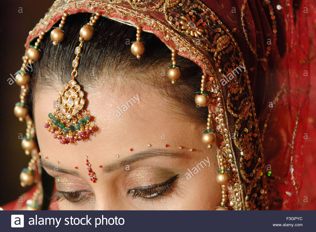 Marriage ornaments - Bride With Pallu Of Sari Covering Head From Back Ornaments And Eye Make Up In Indian