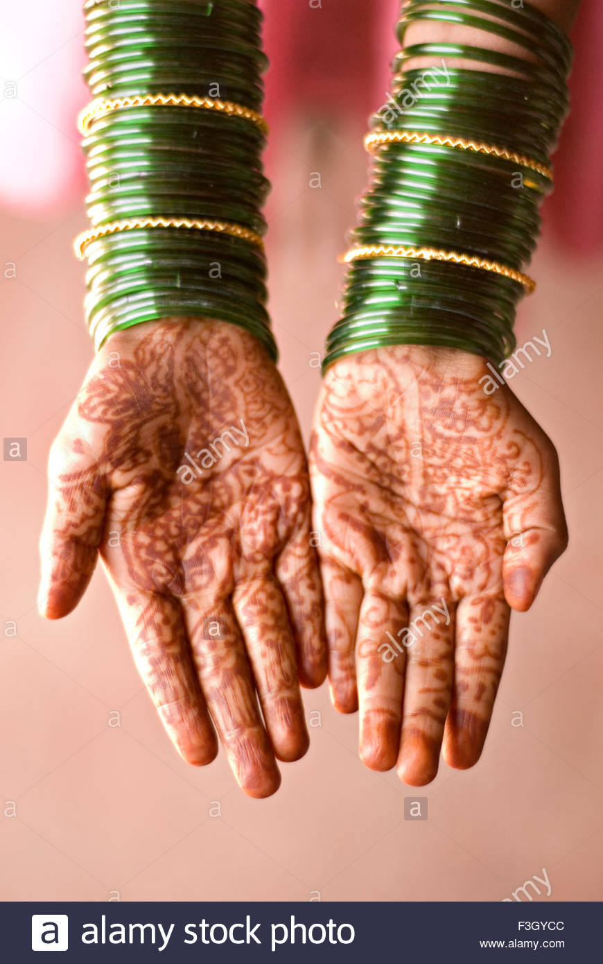 Green bangles in hands and Afrin herbal on palm in rural marriage ...