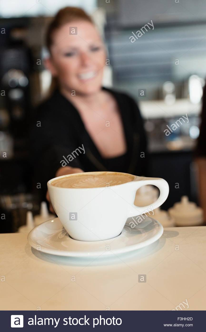 coffee shop barista serving coffee stock photo royalty free image  - coffee shop barista serving coffee