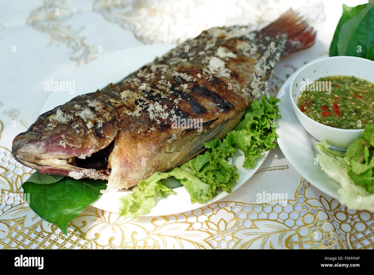 thai food salt grilled fish with side dishes stock photo