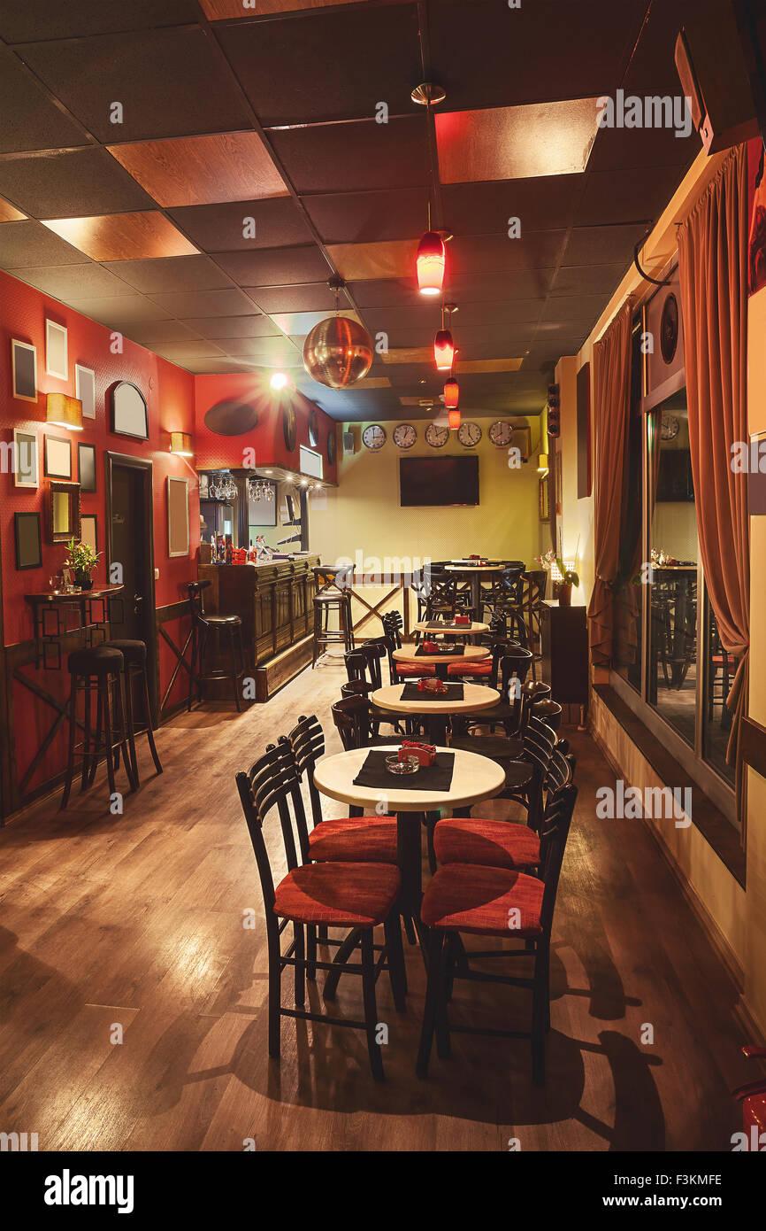 Interior of a modern cafe in retro style night scene for Modern retro interior