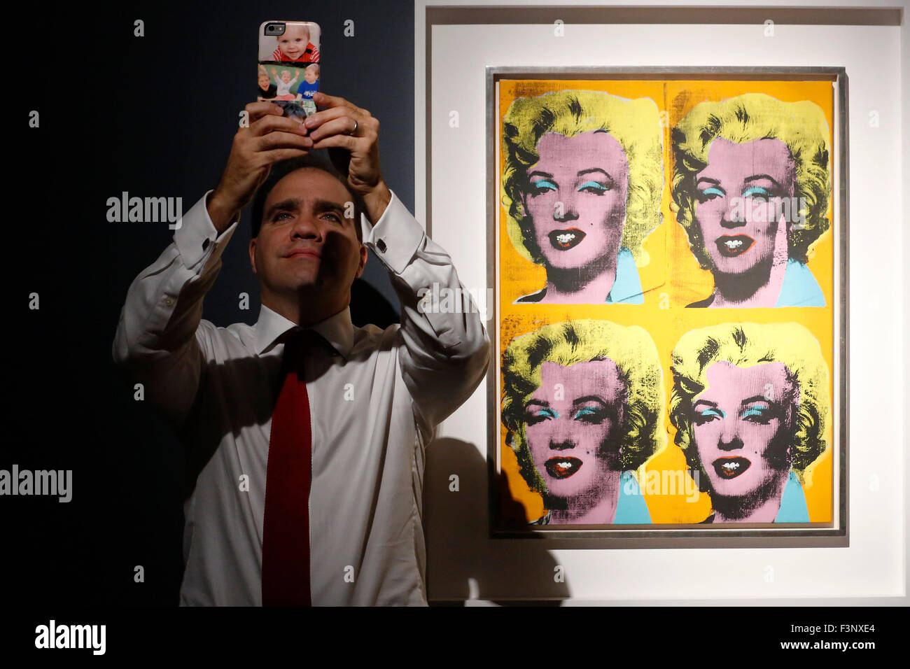 New york usa 11th nov 2015 telephone bidders stand in front of the - Francis Outred Chairman And Head Of Post War And Contemporary Art Emeri Poses
