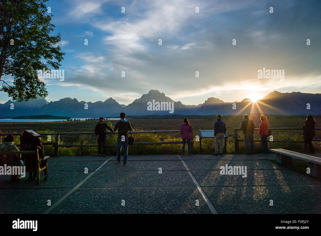 Perfect Stock Photo   Tourists Enjoy Sunset View From Patio Of Famous U0026 Historic  Jackson Lake Lodge; Grand Teton National Park; Teton Range