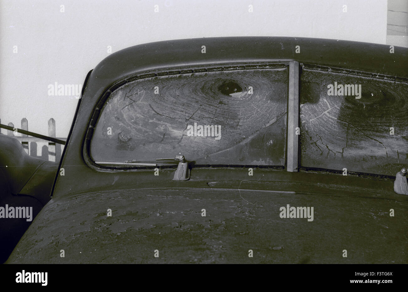windshield of an abandoned car from the 1940s parked in the