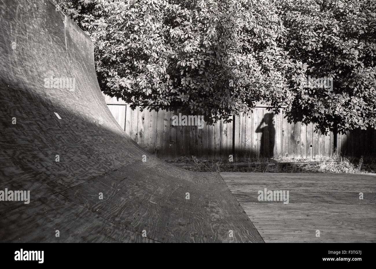 skateboarding half pipe california backyard 1980s stock photo